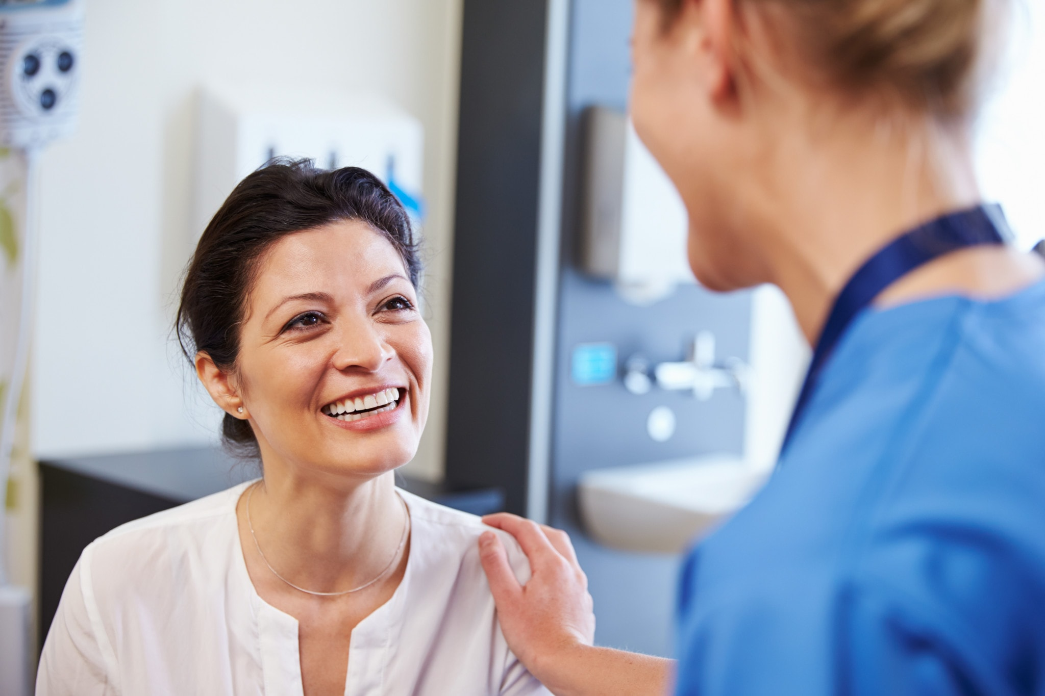 North Texas Gynecologic Oncology - Female Patient Being Reassured By Doctor In Hospital Room